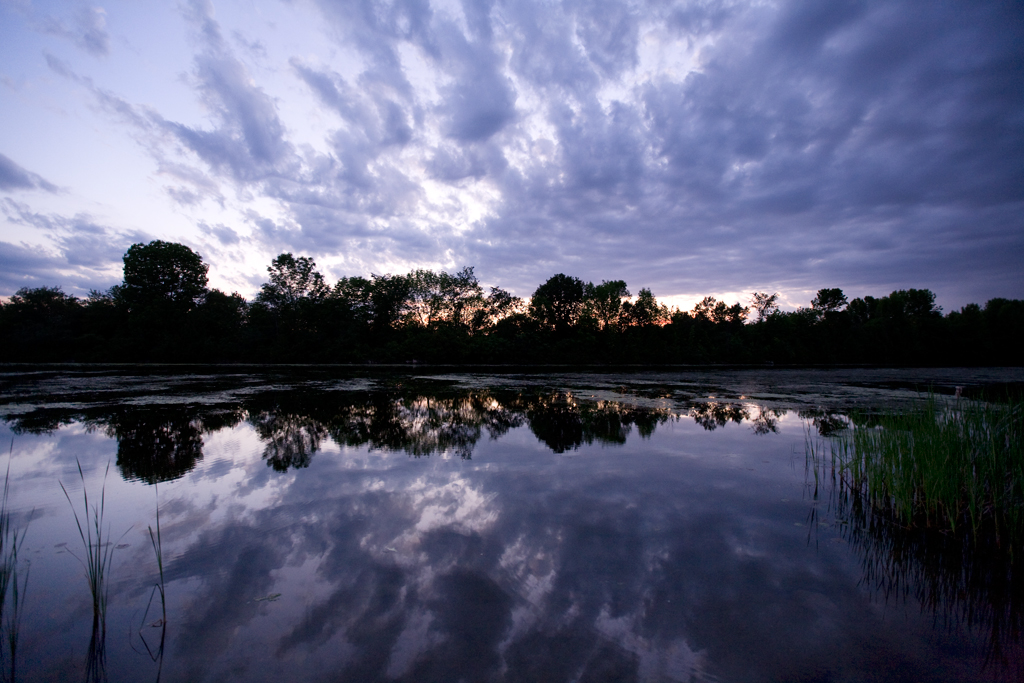 Image of clouds at sunset reflected in the Trent Canal