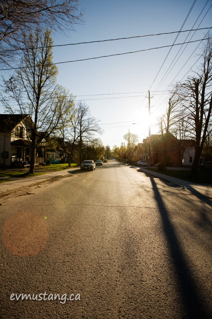 image of sun shining on a dowtown residential street