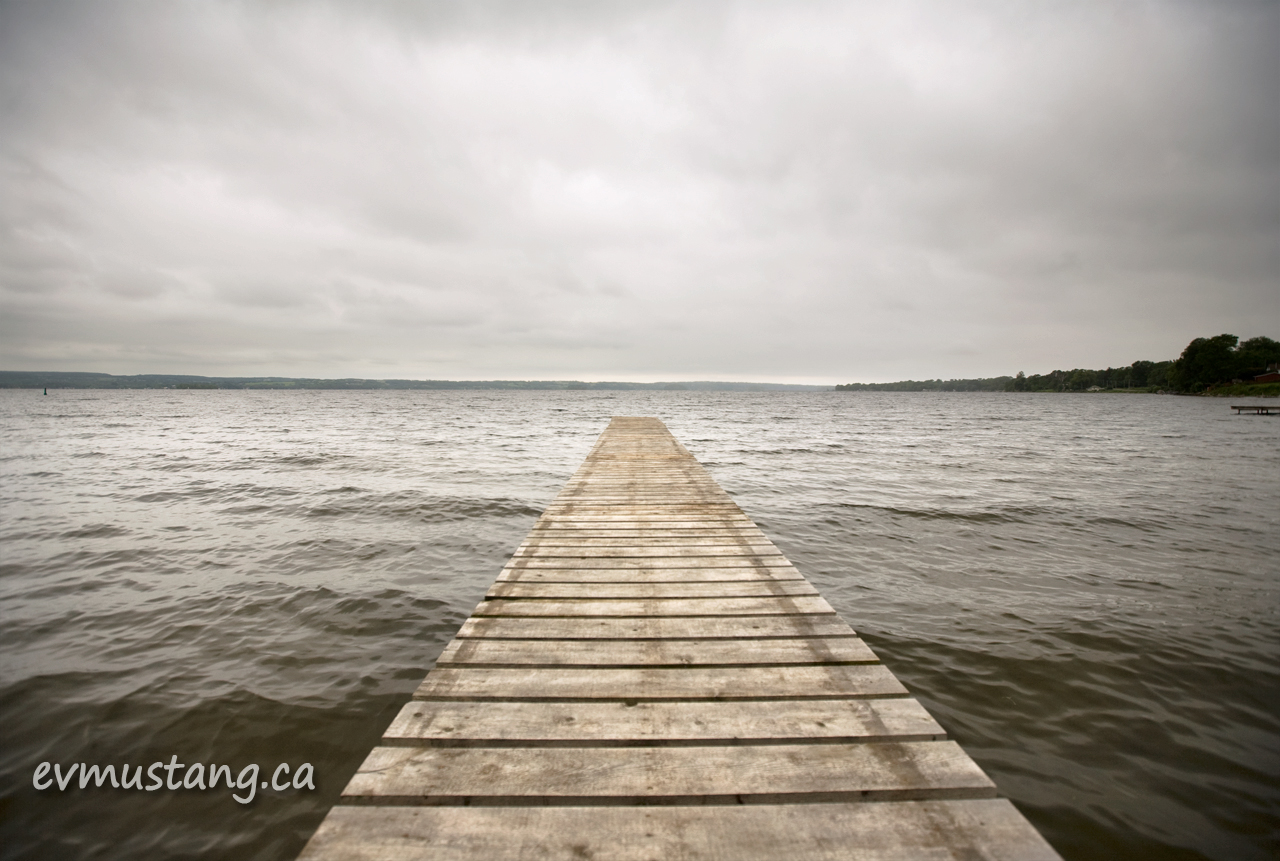 image of dock leading into a lake