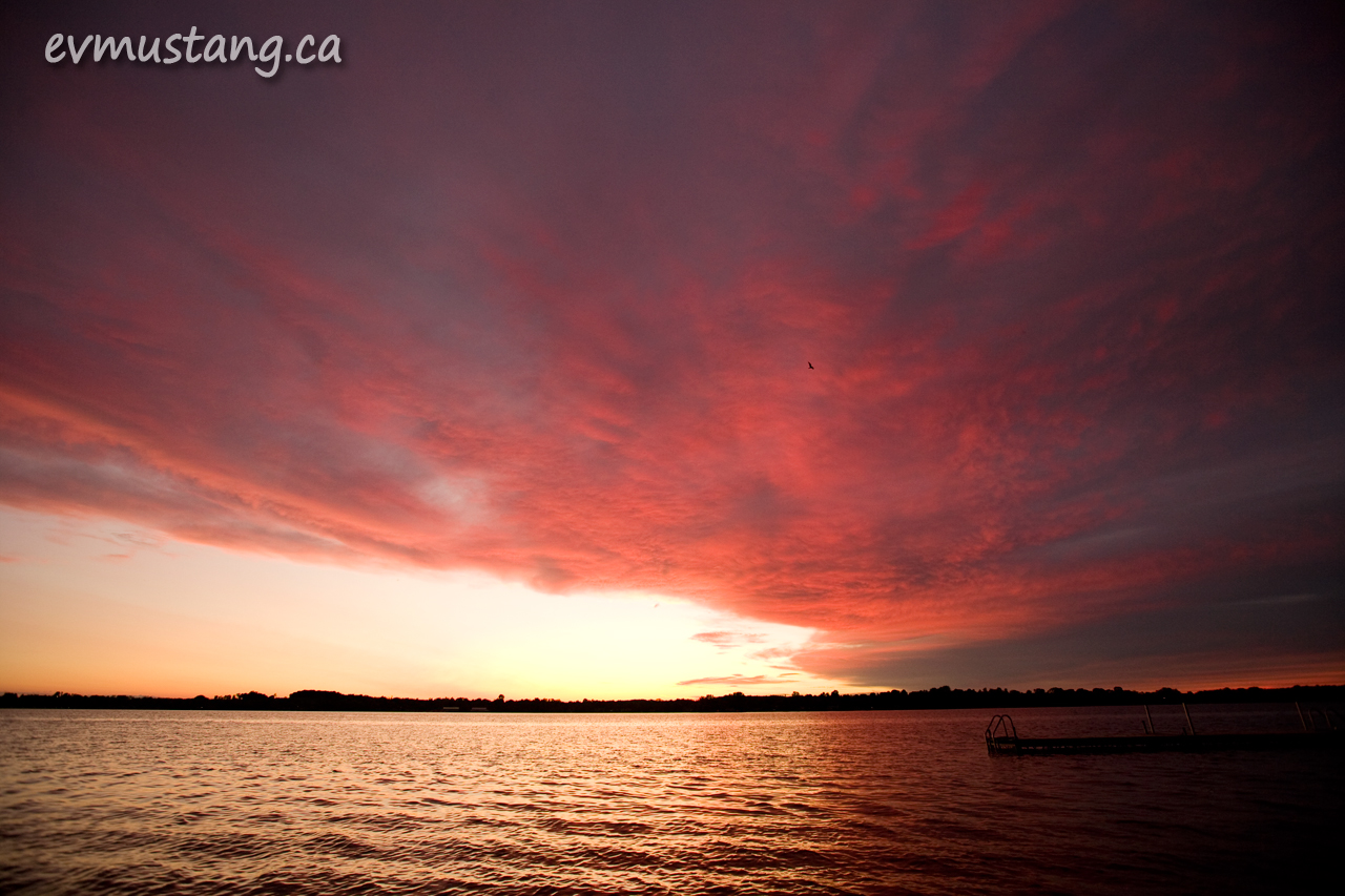 image of a magenta sunset over water
