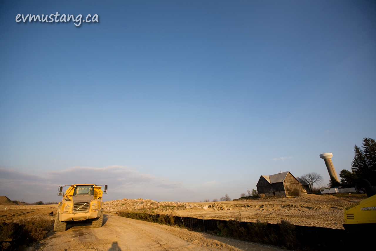 image of dump truck in farmside construction site