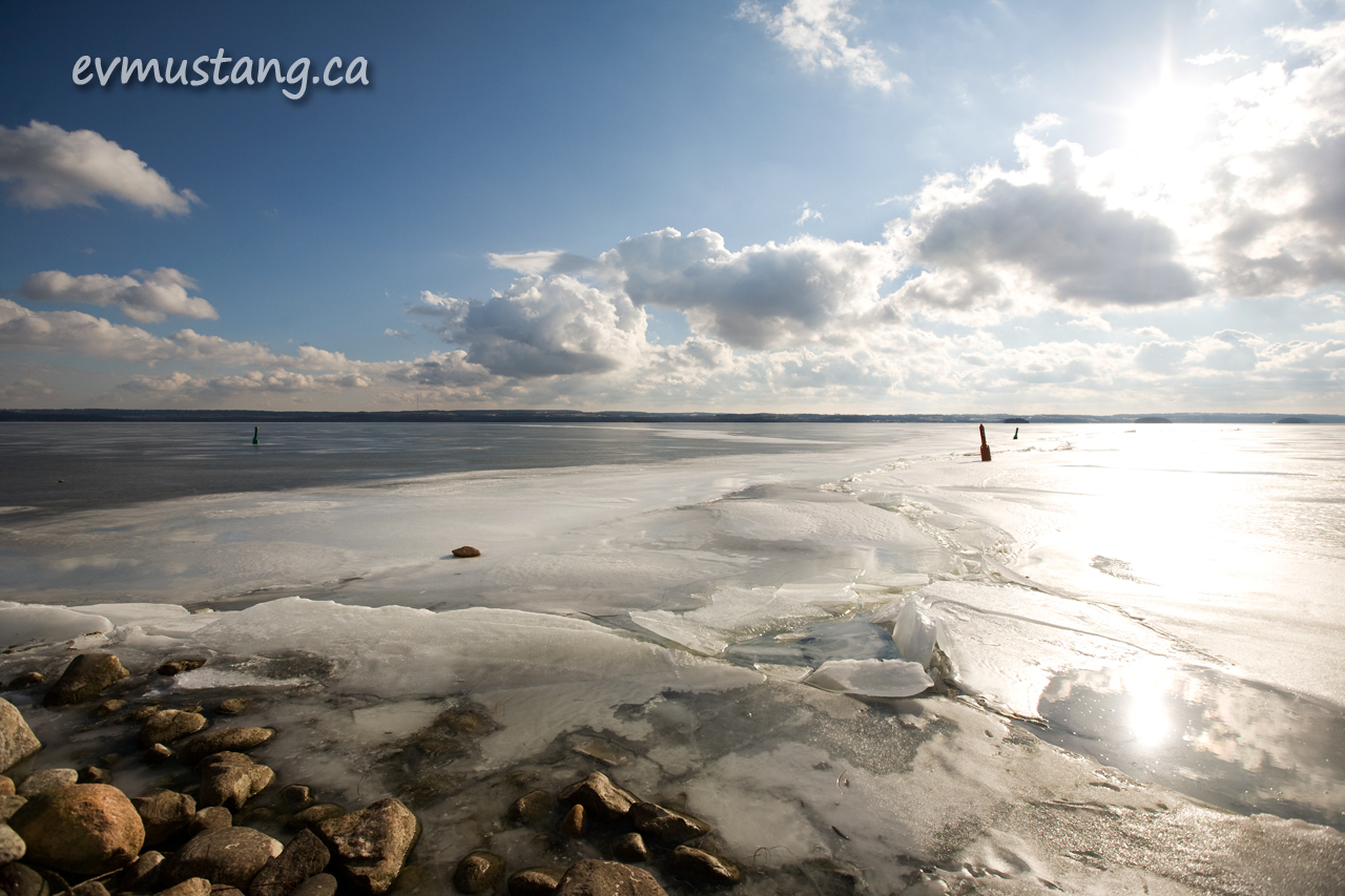 image of frozen lake with pressure break under sun