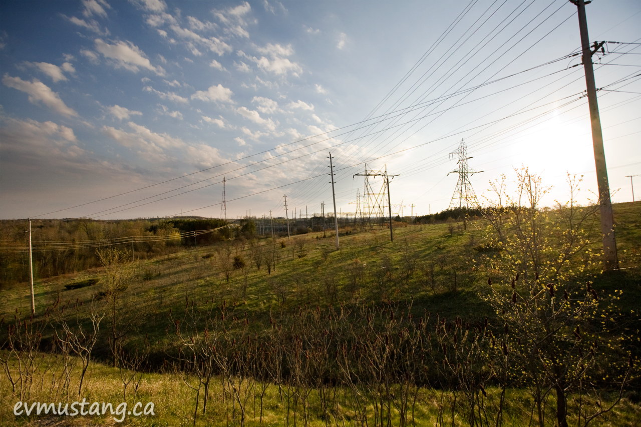 image of power lines over spring fields