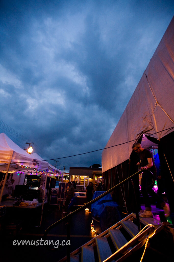 image of storm clouds over the backstage of an outdoor street festival