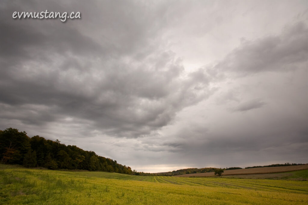 image of rain clouds over autumn landscape