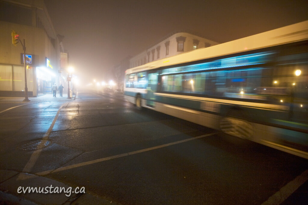 image of bus speeding past in the fog