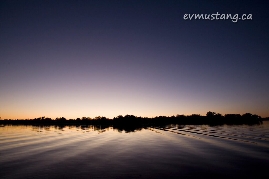 image of sunset over water with trees