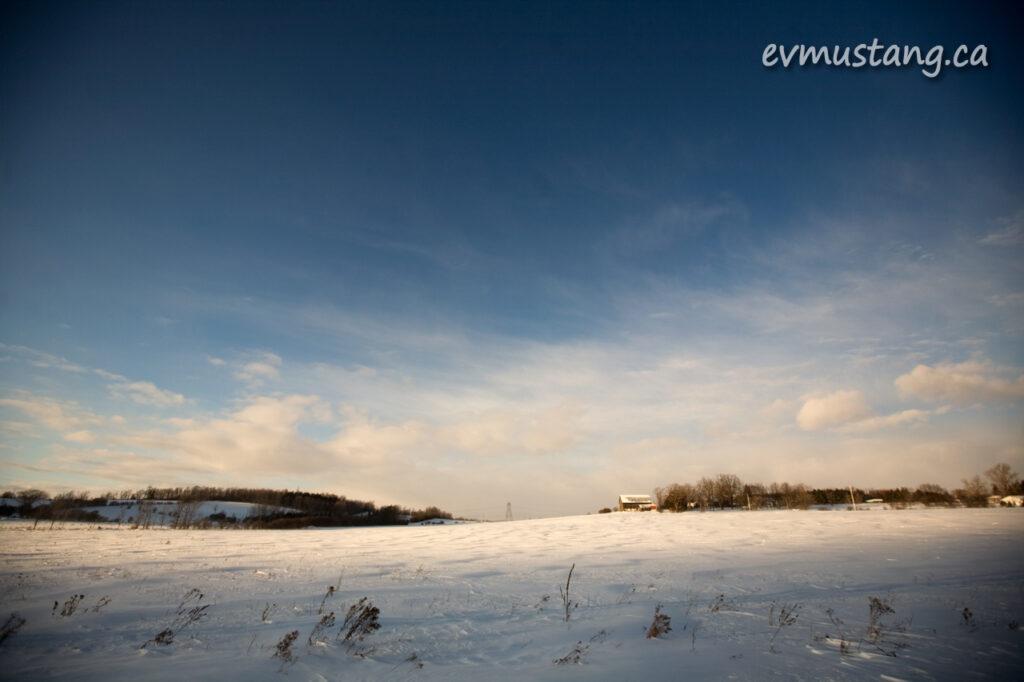 image of sunlit snowy farm field