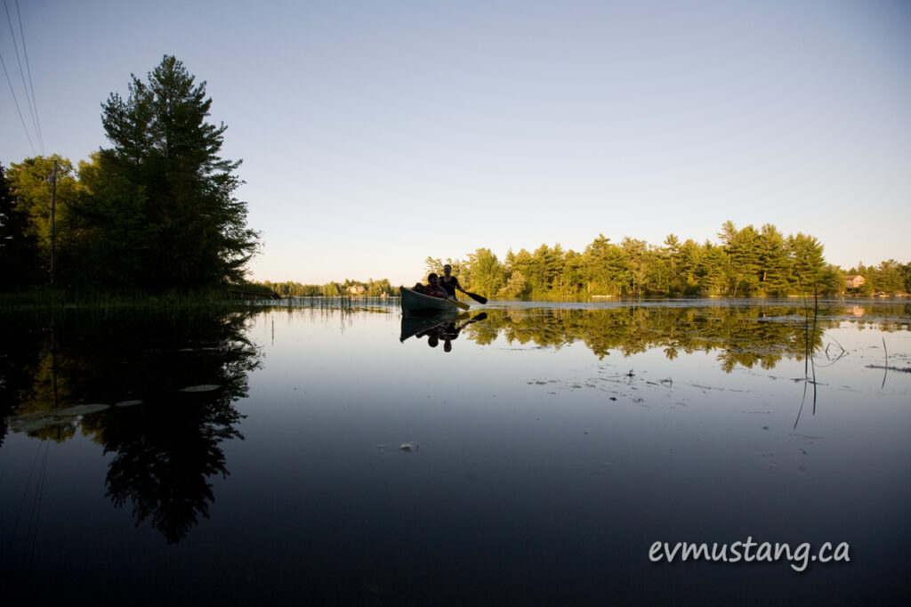 image of canoe on still water in Stony Lake