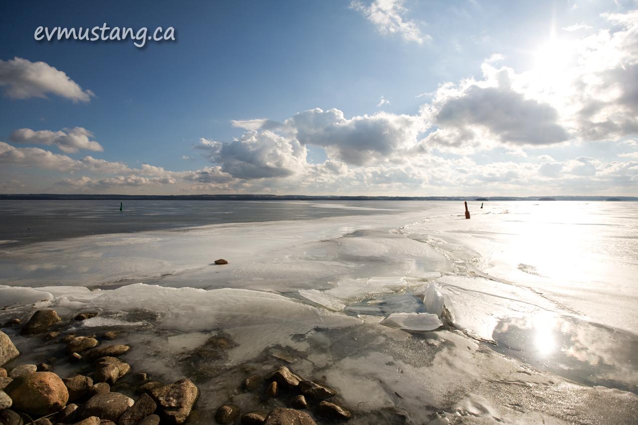 image of frozen lake with pressure break under sun