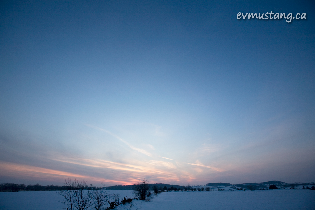 image of sunset over snowy fields