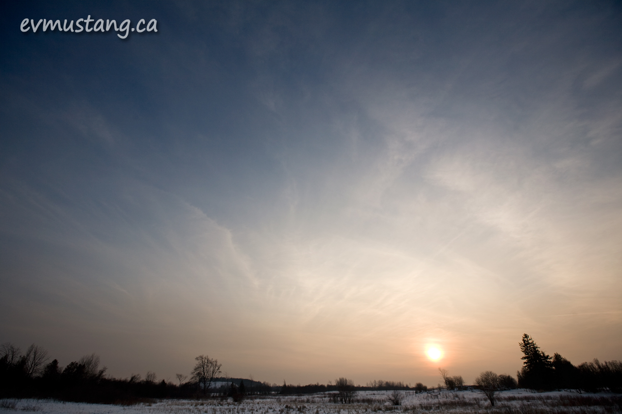 image of sunset over snowy field
