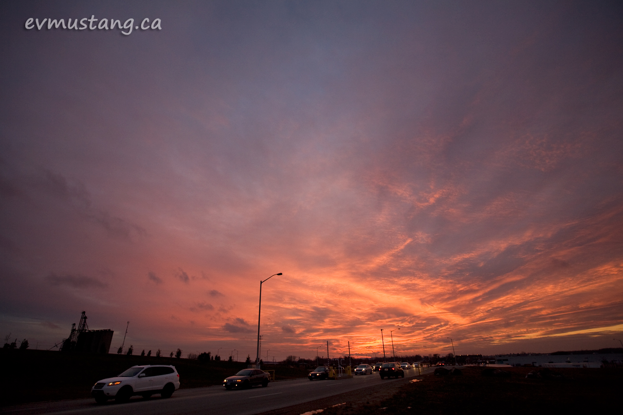 image of sunset over the shift change at the toyota plant, woodstock, ontario